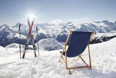 Cross ski and Empty sun-lounger at mountains in winter Royalty Free Stock Photo