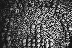 Cross of Skulls in the Catacombs of Paris Stock Photography