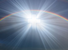 Cross in sky. Sign of faith. Cross in sky with rainbow Stock Photos