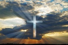 Cross in the sky. At sunset with rays of light Royalty Free Stock Photo