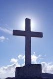 Cross and Sky. Cross sillouette against a blue sky Royalty Free Stock Photos
