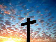 Cross in the sky. Cross silhouette in a beautiful cloudy sky Royalty Free Stock Image