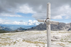 Cross with sky and mountains in background. Cross made of raw wood with sky and mountains in background Royalty Free Stock Photography
