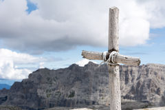 Cross with sky and mountains in background. Cross made of raw wood with sky and mountains in background Stock Photography