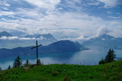 Cross on slope of Rigi mountai. N with view on lake Lucerne on background Stock Photo