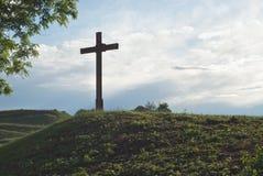 Cross on a Small Hill. Devotional Cross as Symbol of Christian Faith on Hill Royalty Free Stock Photos
