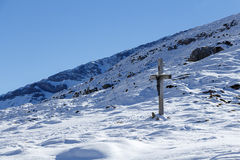 Cross in the Snow Royalty Free Stock Image