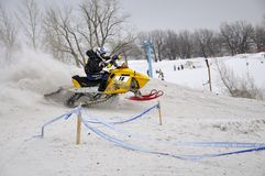 Cross snowmobile rider quickly Royalty Free Stock Photos