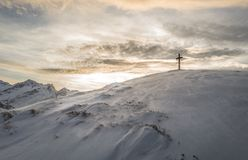 Cross On A Snowy Mountain Stock Images