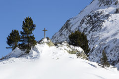 Cross in snowy mountain landscape. Of the Austrian Alps Royalty Free Stock Image