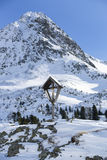 Cross in snowy mountain landscape. Of the Austrian Alps Stock Photo