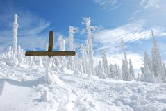 Cross in the snowy mountains. Holly cross in the top of the winter snowy mountains Royalty Free Stock Images
