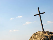 Cross with space for text. Cross on a grave against a blue sky.  space for copy (text Royalty Free Stock Photo
