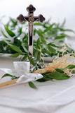 Cross and sprinkler of holy water before wedding ceremony Royalty Free Stock Images