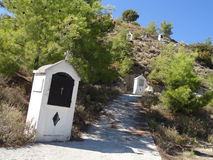 Cross stations next to the Monastery of Madonna Ipseni. Picturesque hill with Stations of the Cross. The monastery of Panaghia of Ipseni, Rhodes, Greece royalty free stock images