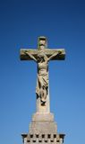 Cross statue crucifixion. Detail of the christian cross. Blue sky royalty free stock photo