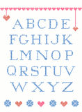 Cross stitch alphabet. With design element suitable for christmas Royalty Free Stock Image