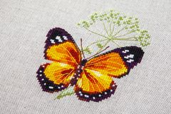 Cross-stitch butterfly with pink wings stock photos