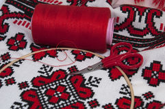 Cross-stitch canvas with red thread, close up shot Royalty Free Stock Images