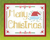 Cross-stitch Christmas  greeting on the wall. Cross-stitch Christmas  greeting in the green background Royalty Free Illustration