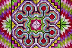 Cross-stitch cloth. Colorful cross-stitch cloth background stock photo