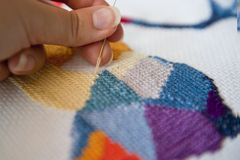 Cross stitch. Crafting material on white background royalty free stock photo
