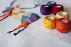 Cross stitch. Crafting material on white background stock photos