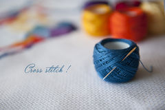 Cross stitch. Crafting material on white background Stock Photography