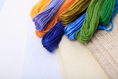 Cross-stitch crafts. Different color hreads and canvas for cross-stitch royalty free stock photography