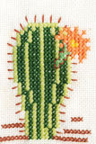 Cross-stitch embroidery of cactus with flower Stock Photography