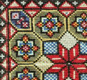 Cross stitch embroidery. Close-up geometric colorful stitch ornament Stock Images