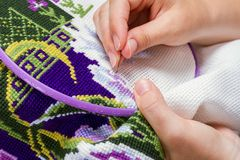 Cross-stitch embroidery, close-up Stock Photos