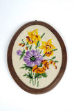 Cross Stitch Embroidery. Cross stitch colorful flower embroidery on canvas Royalty Free Stock Images
