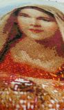 Cross stitch Embroidery our lady portrait Stock Photos