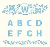 Cross-stitch embroidery in Ukrainian style, embroidered flowers and ABC, floral border. Design elements for cross-stitch embroidery. Blue colors, vector royalty free illustration