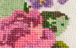 Cross-stitch made ​​with colored threads for embroidery - mu Royalty Free Stock Photos