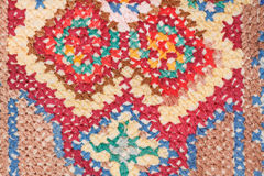 Cross stitch needlework close up. Vintage knitting craftsmanship - cross stitch needlework close up Royalty Free Stock Photos