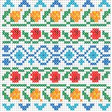 Cross stitch pattern for clothing with elements of folk embroide. Cross stitch colorful pattern for clothing with colorful elements of folk embroidery Royalty Free Stock Photo