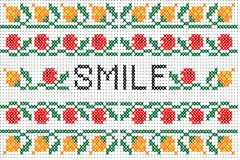 Cross stitch pattern  with elements of folk embroidery and word. Cross stitch colorful pattern  with elements of folk embroidery and word SMILE Royalty Free Stock Photo