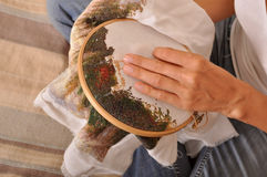Cross stitch process close-up stock photos