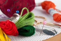 Cross-stitch set. On linen stock photos