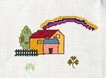 Cross-stitch set. Cross-stitched house on canvas Stock Photo