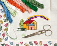Cross-stitch set. With threads and scissors Royalty Free Stock Images