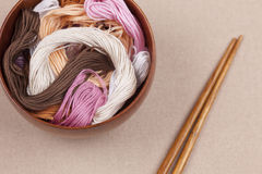 Cross-stitch threads in bowl Stock Photo