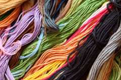 Cross-Stitch Threads. Colorful cross-stitch threads background. Close-up Royalty Free Stock Images
