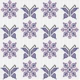 Cross stitch traditional embroidery with butterflies and flowers. Cross stitch traditional embroidery with mauve butterflies and flowers Stock Photos