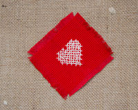 Cross stitched heart. On burlap Royalty Free Stock Photos
