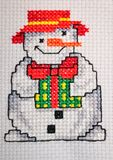 Cross stitched snowman Stock Photos
