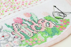 Cross stitching of a baby bib Royalty Free Stock Images