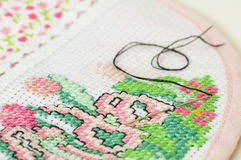 Cross stitching of a baby bib Stock Images